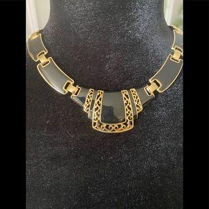 Women's black & gold tone statement necklace.